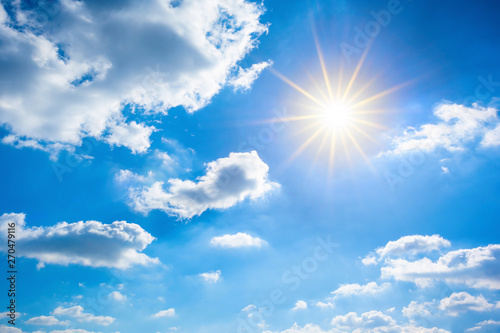 Fototapeta  Sunny background, blue sky with white clouds and sun