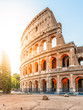 Colosseum, or Coliseum. Morning sunrise at huge Roman amphitheatre, Rome, Italy.