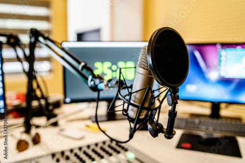 Fotomural Microphone and mixer at the radio station studio broadcasting news