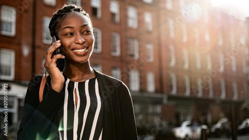 fototapeta na lodówkę Black woman on the phone