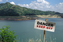 Danger Keep Off Sign With Dam ...