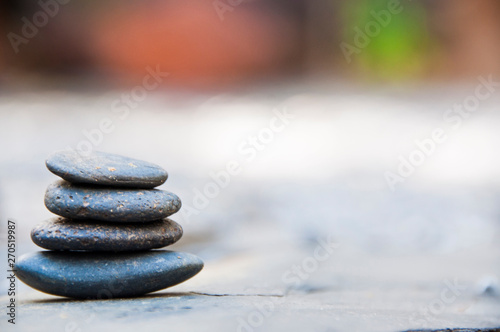 Papiers peints Zen pierres a sable Zen stone on beach for perfect meditation, stack of pebble stones on balance on sand, Pebbles and sand stone composition, Zen stones garden, pile of balanced stone