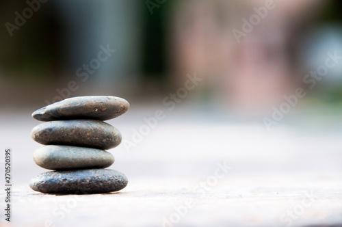 Photo sur Plexiglas Zen pierres a sable Zen stone on beach for perfect meditation, stack of pebble stones on balance on sand, Pebbles and sand stone composition, Zen stones garden, pile of balanced stone