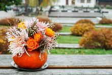 Bouquet Of Flowers In Pumpkin.