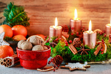 Christmas Decorations: Advent Wreath With Candles, Bowl With Walnuts, Oranges, Wooden Stars.