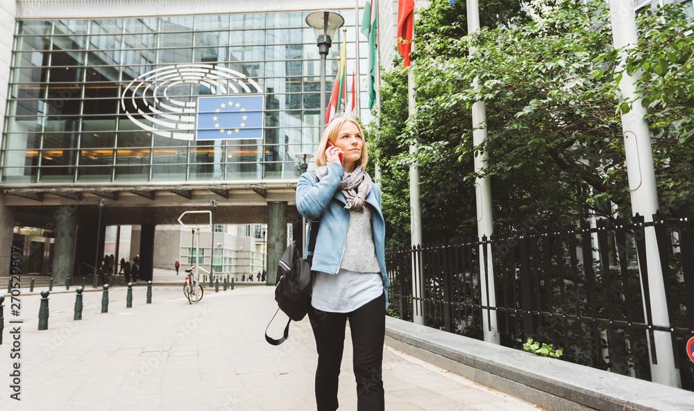 Fototapeta Woman talking on the phone in Brussels, Belgium.