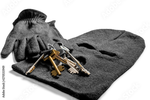 robbery at home objects criminal keys, balaclava and gloves on a white backgroun Canvas Print
