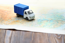 Truck Toy On Map. Concept For Visualization Of Delivery Services, Logistics, Business, Forwarding, Travel, Cargo Delivery. Geographical Concept Of Travel. Banner, Copy Space
