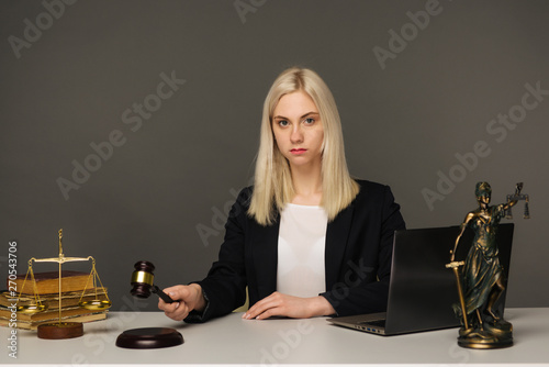 Justice scales, justice hammer and Litigation document, female lawyer working legal law with use laptop at lawyer office Fototapeta