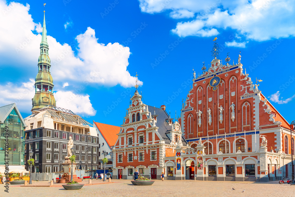 Fototapety, obrazy: View of the Old Town Ratslaukums square, Roland Statue, The Blackheads House and St Peters Cathedral against blue sky in Riga, Latvia. Summer sunny day
