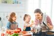 Leinwandbild Motiv Happy family in the kitchen.