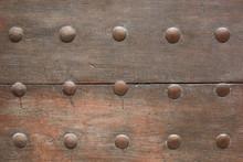 Old Wooden Door With Nails Texture Background