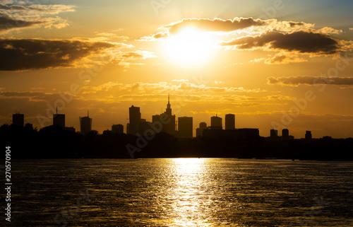 Fototapeta Silhouette of the city of Warsaw. Golden sunset obraz