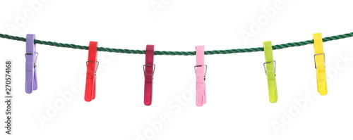 Obraz na plátně  Colorful clothespins on a rope isolated on white background