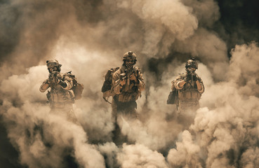 Military soldier between smoke and dust in battlefield