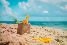Sand Castle And Toys On Tropical Beach Vacation