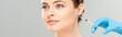 Leinwandbild Motiv panoramic shot of cosmetologist in blue latex glove holding syringe near face of attractive woman isolated on grey