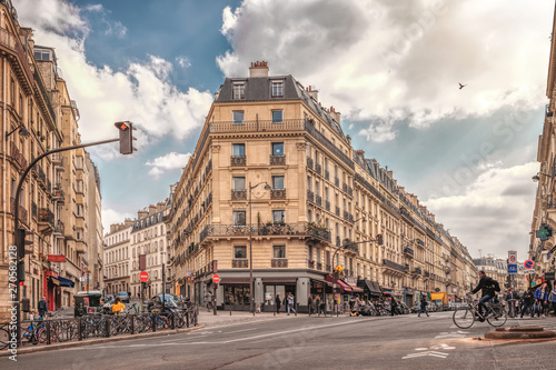 Photo Stands Paris Streets of Paris, France. Blue sky, buildings and traffic. Shot in april daylight.