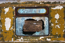Front View Of The Broken Window Glass Of The Old Abandoned Rusty Bus