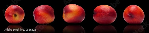 set of juicy, ripe plums isolated lie on a black background - 270586328