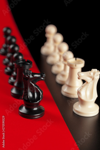 Chess business success, leadership concept. Red background.