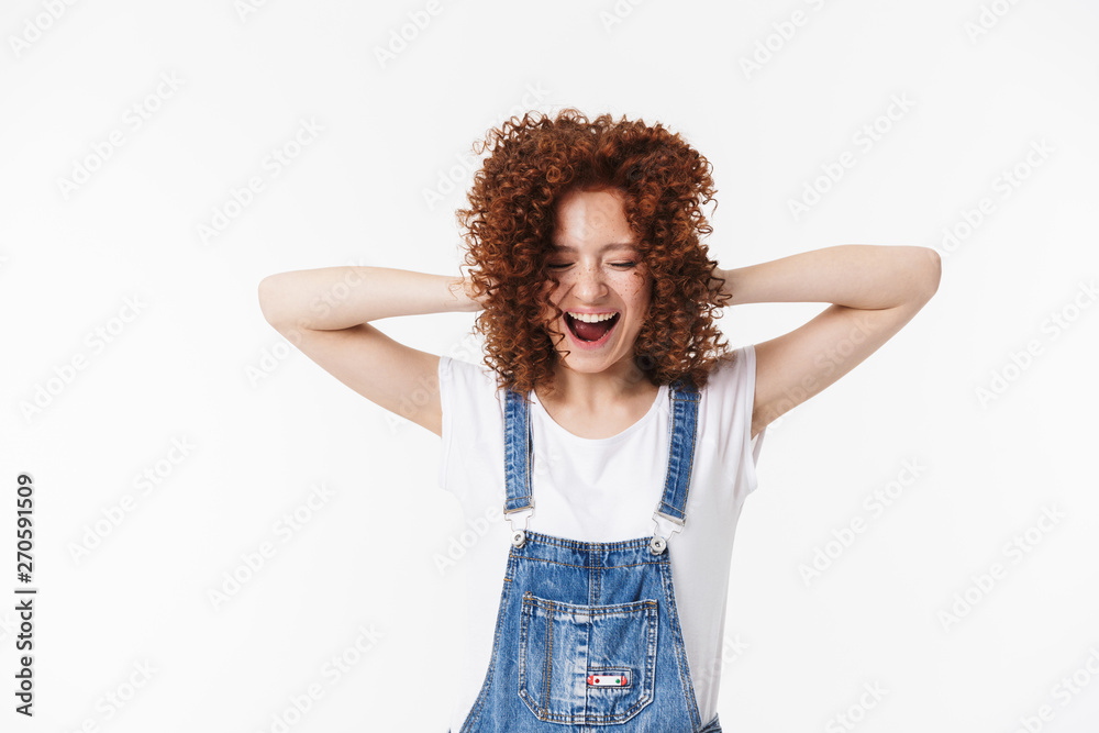 Fototapeta Curly happy redhead girl posing isolated over white background.