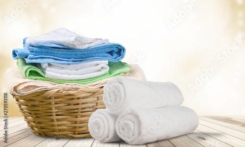 Laundry Basket with colorful towels on background Obraz na płótnie