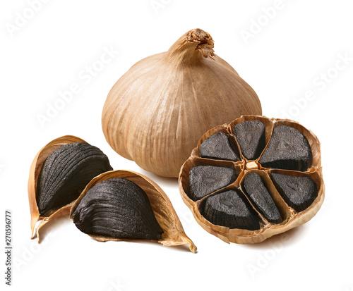 Cuadros en Lienzo  Tasty black garlic isolated on white background