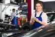 Woman mechanic writing job sheet