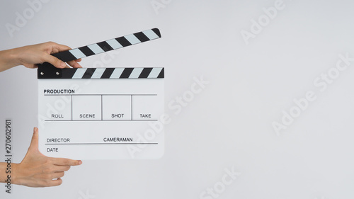 Photo  Hands is holding  Clapperboard or movie slate