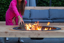 Woman Throws Logs On Fire Pit ...
