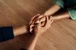Leinwandbild Motiv People holding their hands tight together