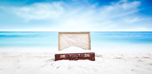 Summer suitcase of sand and...