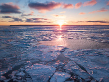 Warm Rays Of Setting Sun Illumine Icy Ontario Lake