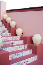 Pink Staircase Designed With Pastel Colors And Vases.