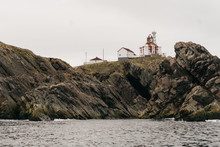 Lighthouse On Top Of Cliff