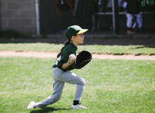Young Baseball Player Catches Ball