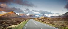 A Rural Road Into A Mountain Range