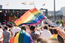 People With Rainbow Flags Attending A Gay Pride