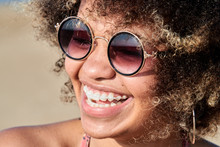 Portrait Of Smiling Black Woman With Sunglasses