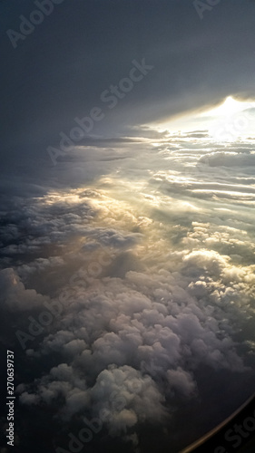 Foto op Plexiglas Hemel Window Seat from Plane Viewing Clouds of the Sunset