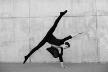 Ballerino Dancing Against Wall