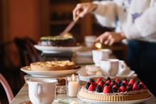 Woman Preparing Sweet Table Fo...