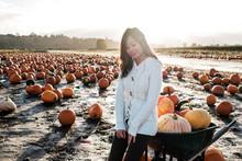 Asian Woman Holding A Pumpkin ...