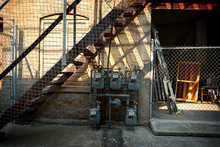 Uban Back Alley With Stairs And Shadows