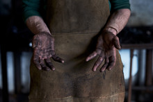 Crop Blacksmith Showing Dirty Hands