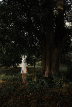 Woman In Rabbit Mask At Tree