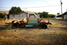 Old Rusted And Dilapidated Truck In Field