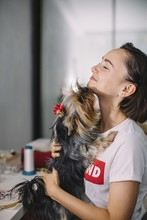 Young Female Having Fun With Her Dog At Jewel Workshop