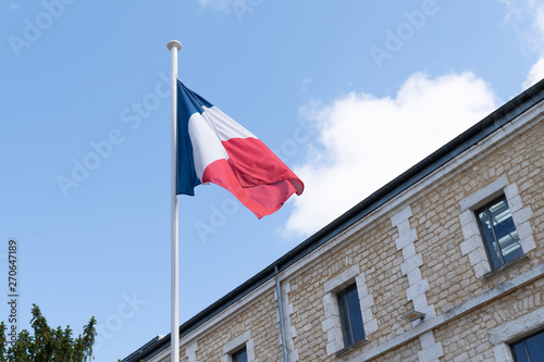 french flag at the top of a mat in a barracks blue white red Wallpaper Mural